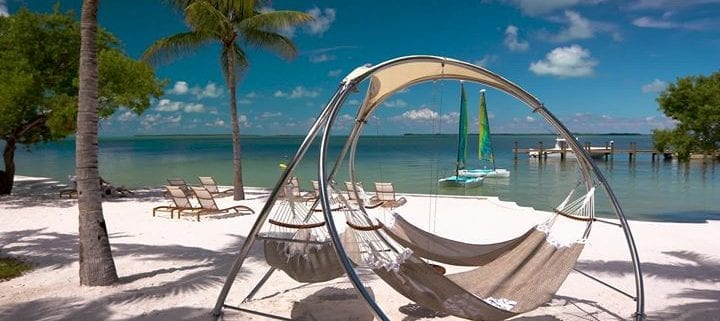 A hammock on the beach with some other chairs down in the Florida Keys.