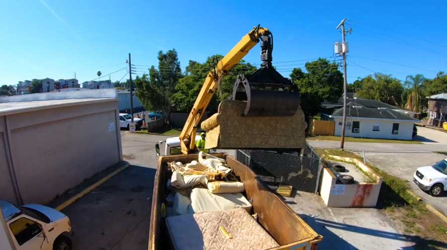 Bulky Trash Collection Using A Grapple Loader
